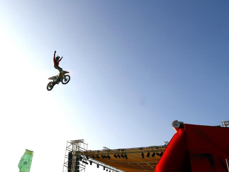 A stunt rider pulls a mean trick at India Bike Week 2014, held on January 17 and 18, in Goa. (Ajay Aggarwal/HT)