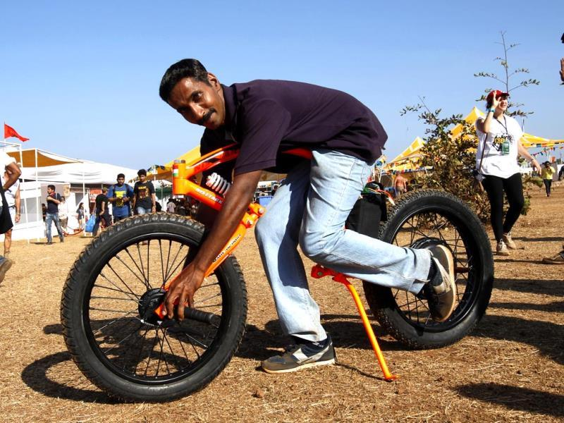 Santhosh, with India's first electric concept bike that he has developed, at the second day of the India Bike Week 2014, in Goa. (Ajay Aggarwal/HT)