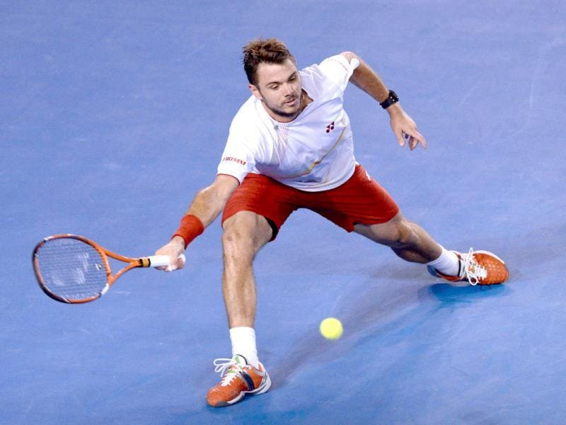 Switzerland's Stanislas Wawrinka plays a shot during his mens singles final match against Spain's Rafael Nadal at the 2014 Australian Open in Melbourne. (AFP Photo)