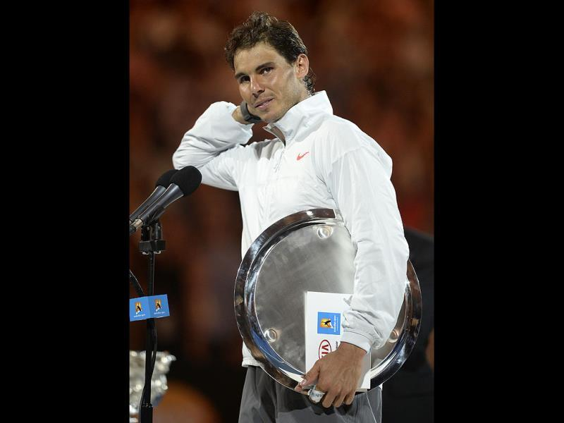 An emotional Rafael Nadal speaks during the trophy presentation at the Australian Open in Melbourne. (AP Photo)