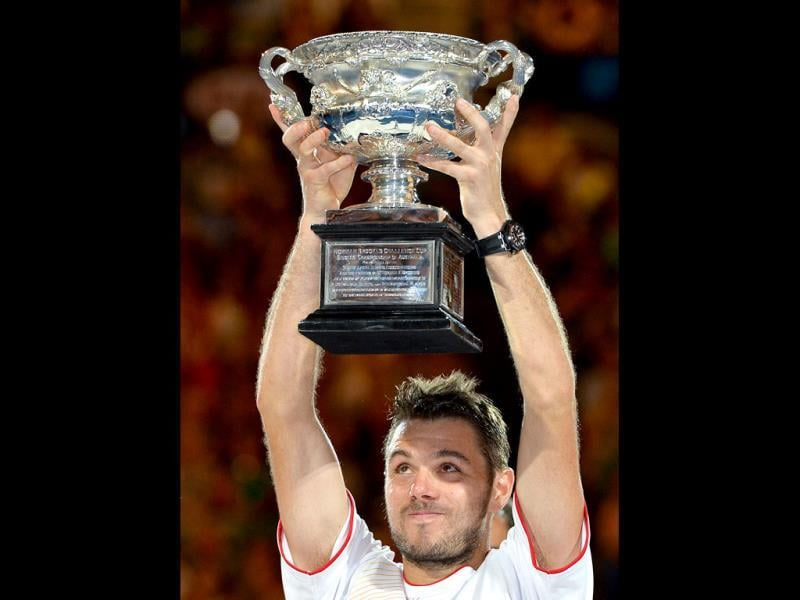 Switzerland's Stanislas Wawrinka holds the trophy after his victory against Spain's Rafael Nadal during the men's singles final of the 2014 Australian Open in Melbourne. (AFP Photo)