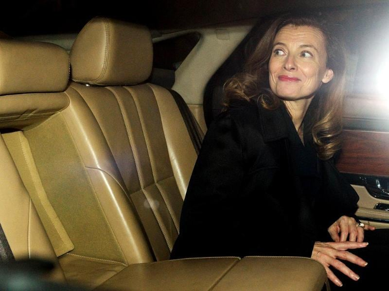 Valerie Trierweiler, the ex-partner of the French President, reacts in a car after arriving at the international airport in Mumbai. (AFP)