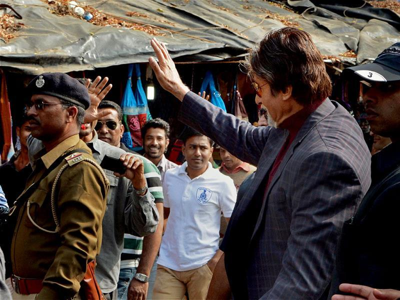 Amitabh Bachchan waves during a shoot in Ahmedabad Law Garden on Sunday. (PTI Photo)