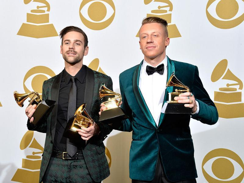 Recording artists Ryan Lewis (L) and Macklemore pose in the press room during the awards. They won four Grammy awards including best new artist.