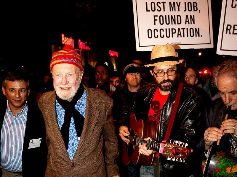 This file photo from 2011 shows Pete Seeger, 92, marching with nearly a thousand demonstrators sympathetic to the Occupy Wall Street protests for a brief acoustic concert in Columbus Circle in New York.