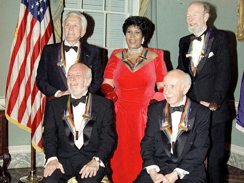 This 1994 file photo shows actor Kirk Douglas, standing from left, singer Aretha Franklin, singer Peter Seeger and seated from left, director Harold Prince and composer Morton Gould pose for photographers after a dinner at the State Department in Washington. The dinner was to honour them as recipients of the Kennedy Center Honours of 1994.