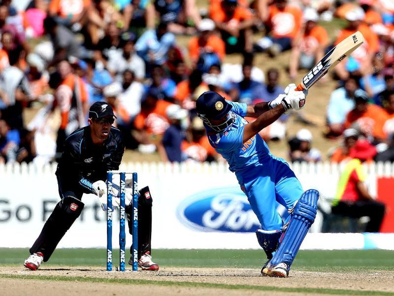 Ambati Rayudu (R) bats as New Zealand's Luke Ronchi fields during their fourth ODI at Seddon Park in Hamilton. (AFP Photo)