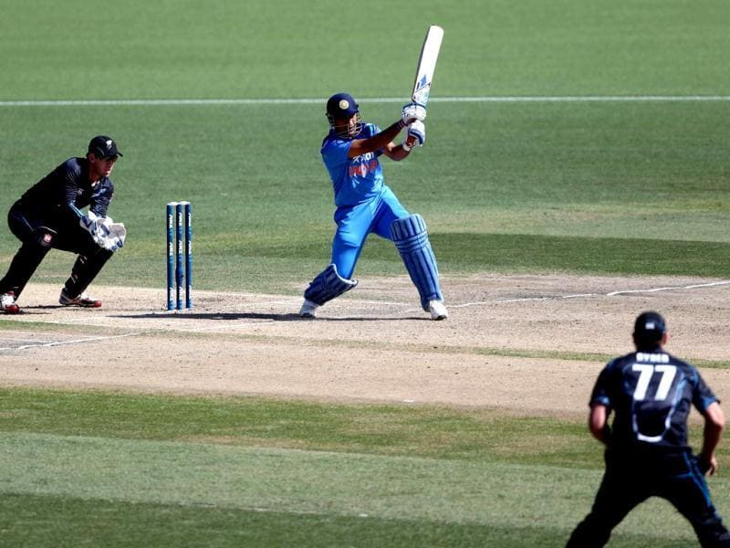 MS Dhoni bats as New Zealand's Luke Ronchi (L) looks on during their ODI at the Seddon Park in Hamilton. (AFP Photo)