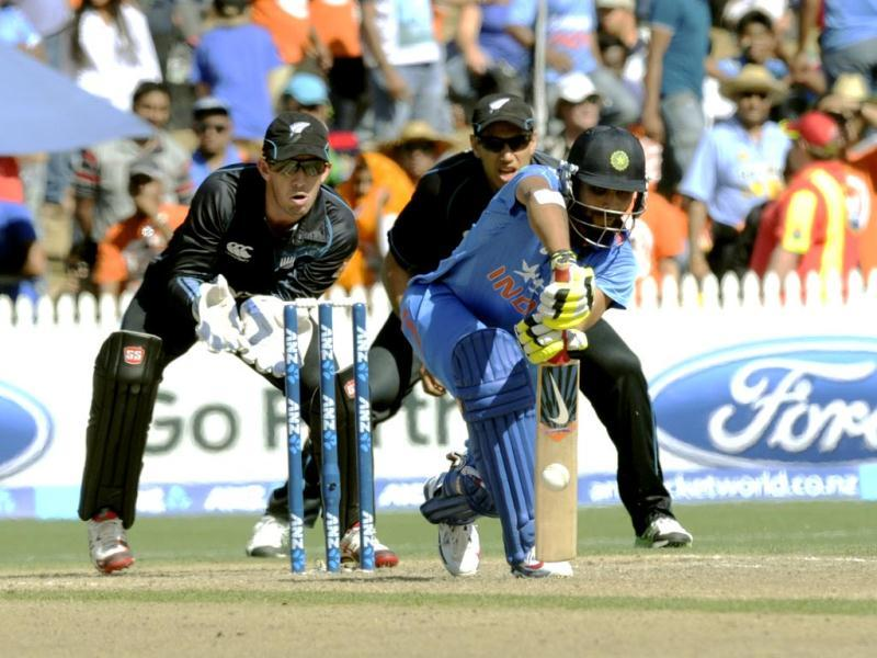 Ravindra Jadeja (C) bats as New Zealand's Luke Ronchi and Ross Taylor look on during their ODI at Seddon Park, in Hamilton. (AP Photo)