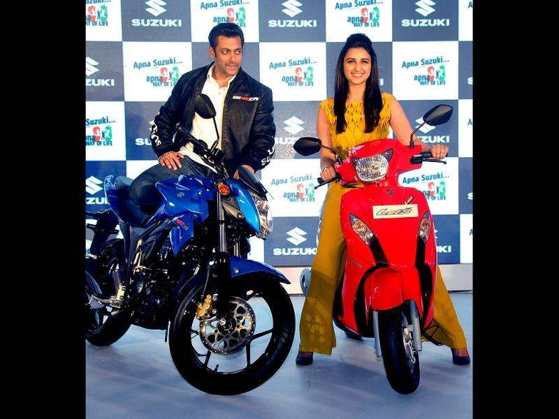 We have a bike each! Parineeti and Salman pose in front of the two-wheelers.