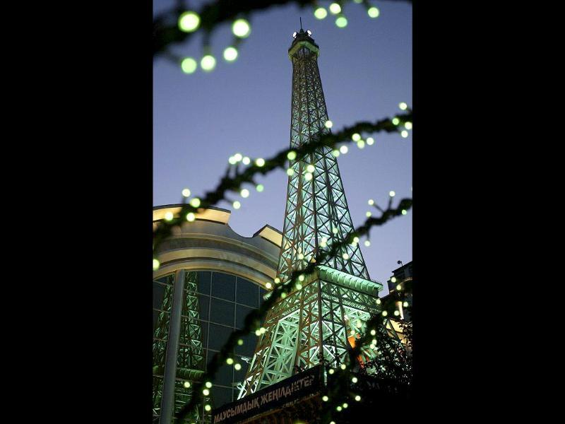 A replica model representing France's Eiffel Tower stands at Europe Park in Torrejon de Ardoz near Madrid. (AFP photo)