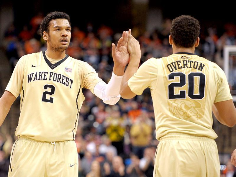 Devin Thomas celebrates with Miles Overton of the Wake Forest Demon Deacons during their game against the Syracuse Orange at Lawrence Joel Coliseum in Winston-Salem, North Carolina. (AFP Photo)