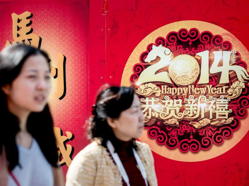 Two women walk past decorations in Hong Kong on the eve of the Lunar New Year. Over a billion Chinese in China and millions more all over the world will be celebrating the Lunar New Year.(AFP photo)