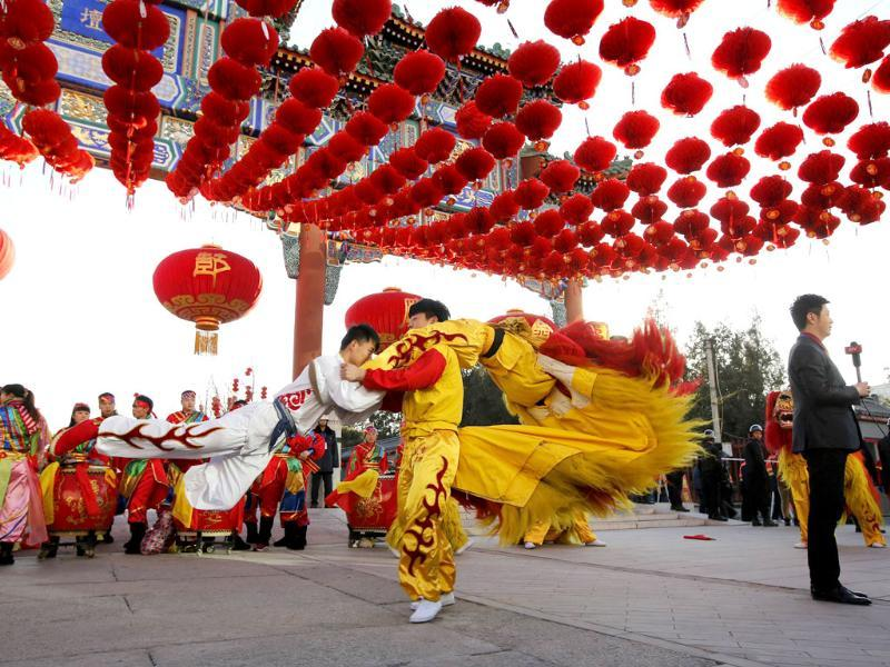 Traditional dancers perform during the opening of the temple fair for the Chinese New Year celebrations at Ditan Park, also known as the Temple of Earth, in Beijing. (Reuters photo)