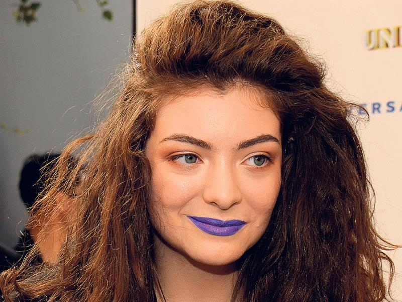 Singer Lorde has become the face of the edgy lip colour trend with her purple and black-hued lips.