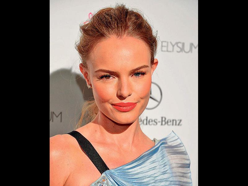 Actor Kate Bosworth in orange.