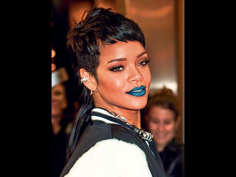 Singer Rihanna in blue lip colour.