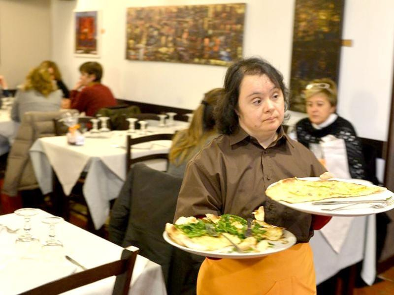 Viviana Polselli, a young women with Down syndrome, works in the restaurant 'Locanda dei Sunflowers' in Rome. (AFP photo)
