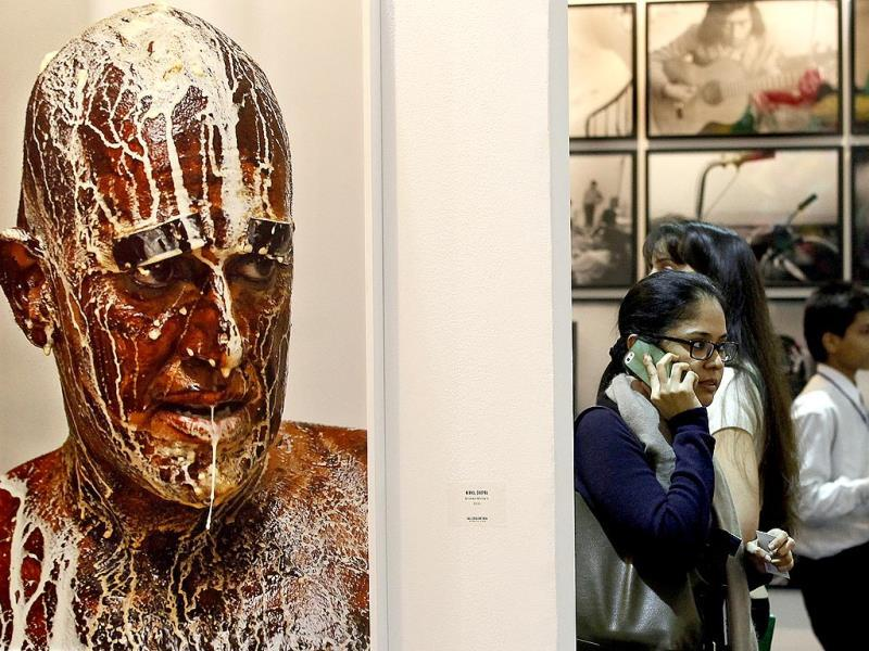 Someone's watching you? A visitor at the 6th edition of India Art Fair. (HT Photo/Raj K Raj)