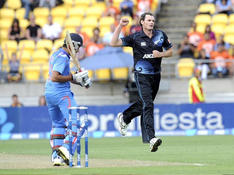 New Zealand's Kyle Mills celebrates after Shikhar Dhawan (L) was caught by Ross Taylor for 4 in their fifth ODI in Wellington. (AP Photo)