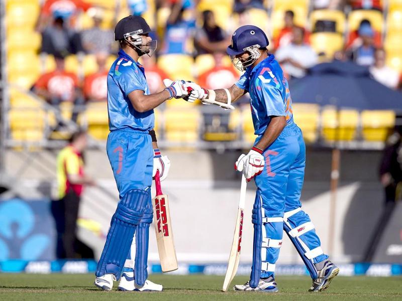 Virat Kohli (L) celebrates with team mate Ajinkya Rahane during the fifth and final OSI against New Zealand in Wellington. (AFP Photo)