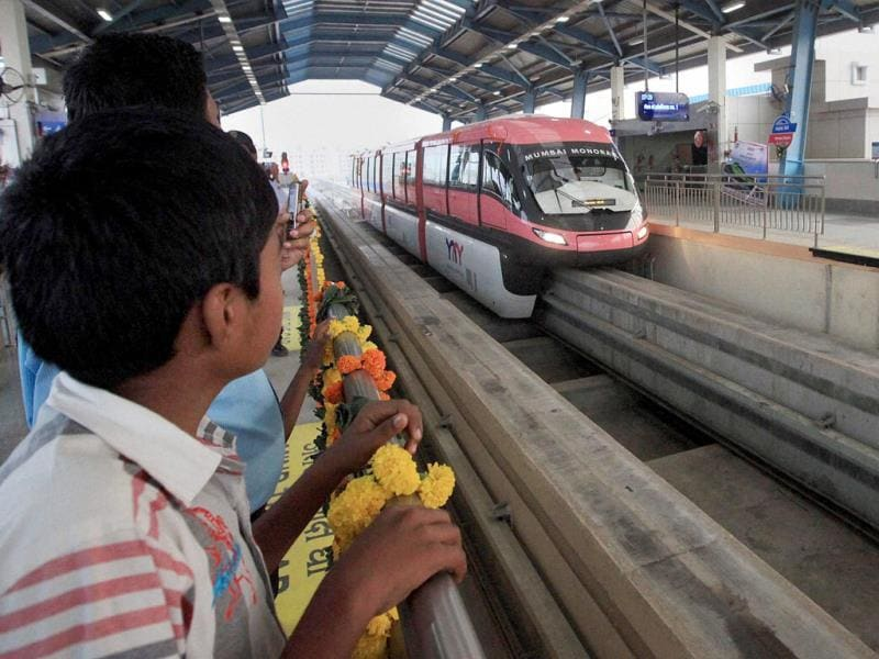Commuters enjoy the first ride of monorail in Mumbai. PTI Photo