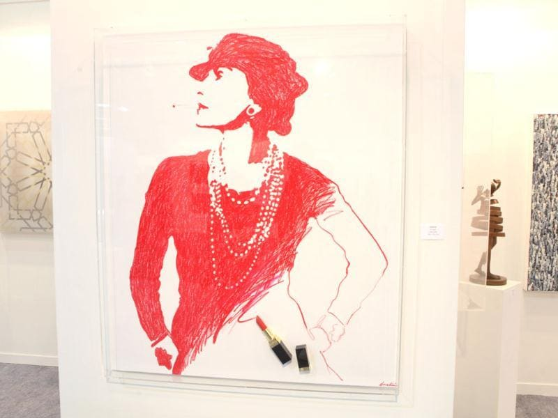 French artist Donadini has made a portrait of Coco Chanel with red lipstick.