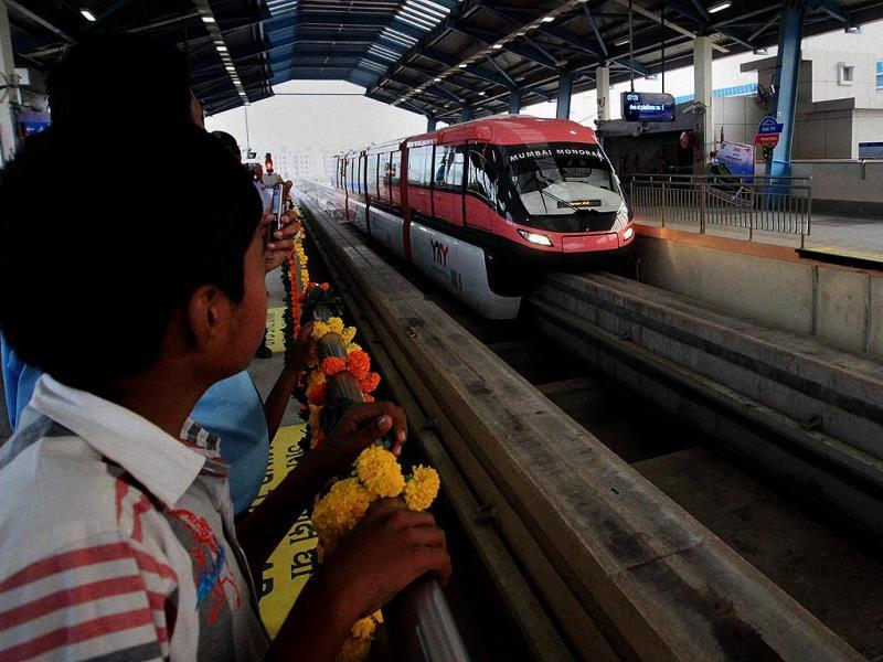 People enjoying the first ride of the monorail in Mumbai. (PTI Photo)