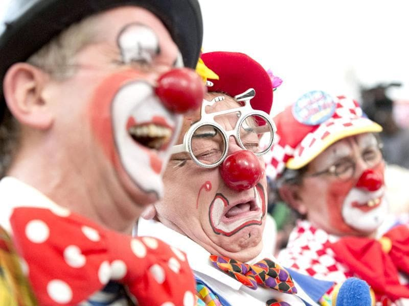 Clowns react during a church service in memory of Joseph Grimaldi at Holy Trinity Church in Dalston, east London. (Reuters photo)