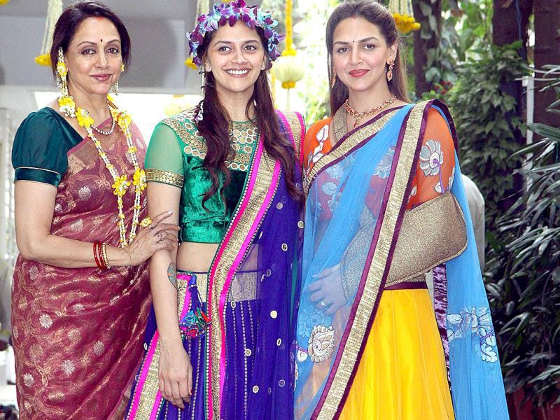 Bollywood actress Hema Malini with her daughters, Esha Deol and Ahana Deol at the mehendi function of Ahana Deol in Mumbai on Friday. (PTI Photo)
