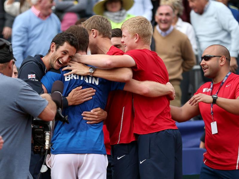 Andy Murray of Great Britain is hugged by team mate James Ward after his four set victory against Sam Querrey of the United States during day three of the Davis Cup World Group in San Diego. (AFP Photo)