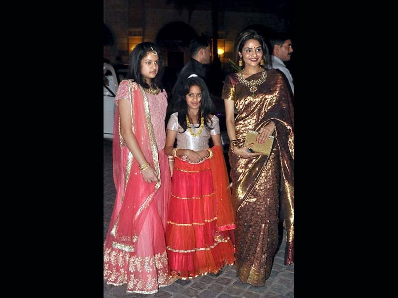 Madhu poses with her daughters as they attend the wedding reception of actress Ahana Deol and husband Vaibhav Vohra. (AFP Photo)