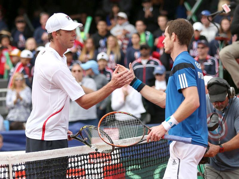 Andy Murray of Great Britain shakes hands at the net after his four set victory against Sam Querrey of the United States during day three of the Davis Cup World Group first round in San Diego. (AFP Photo)