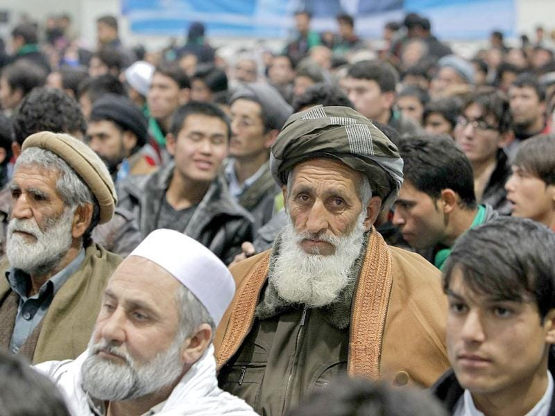 Supporters of Zalmai Rassoul listen to him speak in Kabul. (Reuters)