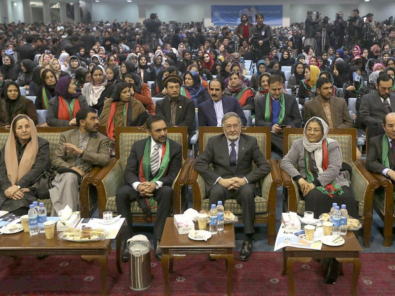 Afghan presidential candidate Zalmai Rassoul (C), with his two vice-presidential candidates, Ahmad Zia Massoud (L) and Habiba Surabi (R) at an election gathering in Kabul. (Reuters)
