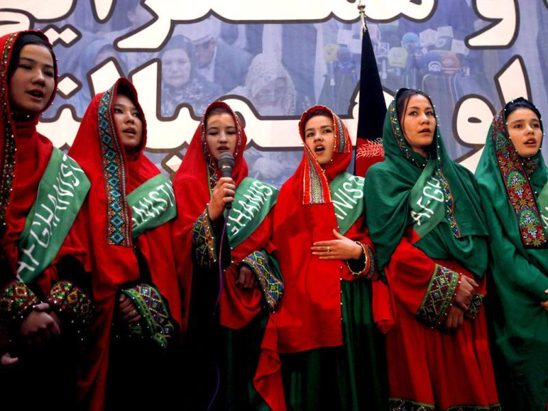 Supporters of Afghan presidential candidate Abdullah Abdullah sing a song during the first day of the presidential election campaign in Kabul. (Reuters)