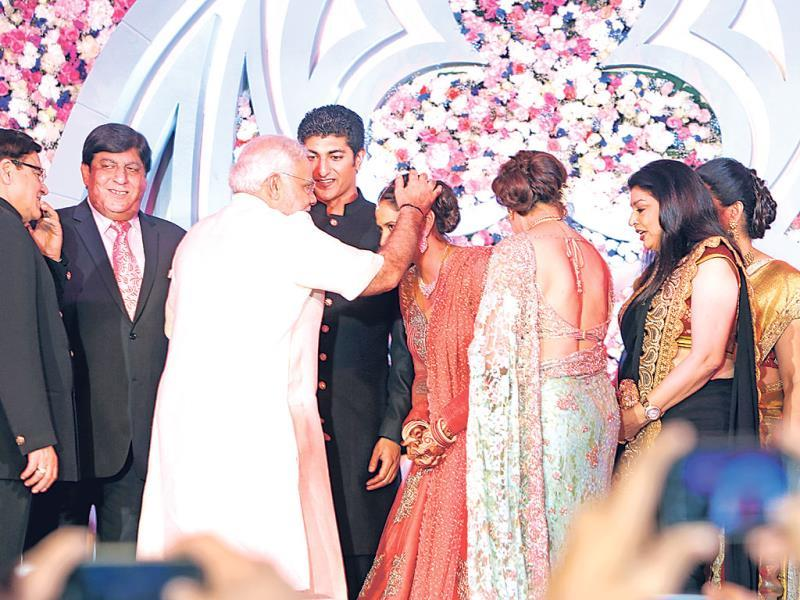 Vaibhav Vohra and Ahana Deol being blessed by Narendra Modi.
