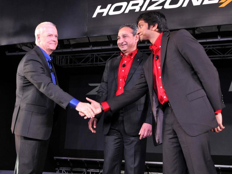 Tata Motors' head of research and development, Tim Leverton and president, passengers vehicles, Tata Motors Ranjit Yadav with Narain Karthikeyan during launch of the company's two new cars - the sedan Zest and a premium hatchback, Bolt, in New Delhi. (Photo by Mohd. Zakir/ Hindustan Times)