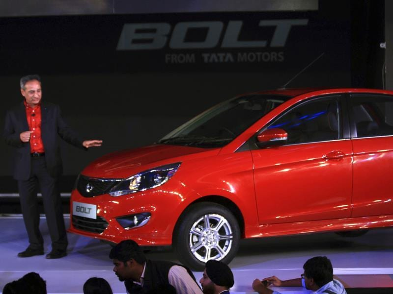 Tata Motors' passenger vehicles president Ranjit Yadav introduces a premium hatchback, Bolt, in New Delhi. The Indian automaker unveiled two new cars, the sedan Zest and Bolt. (AP Photo/Tsering Topgyal)