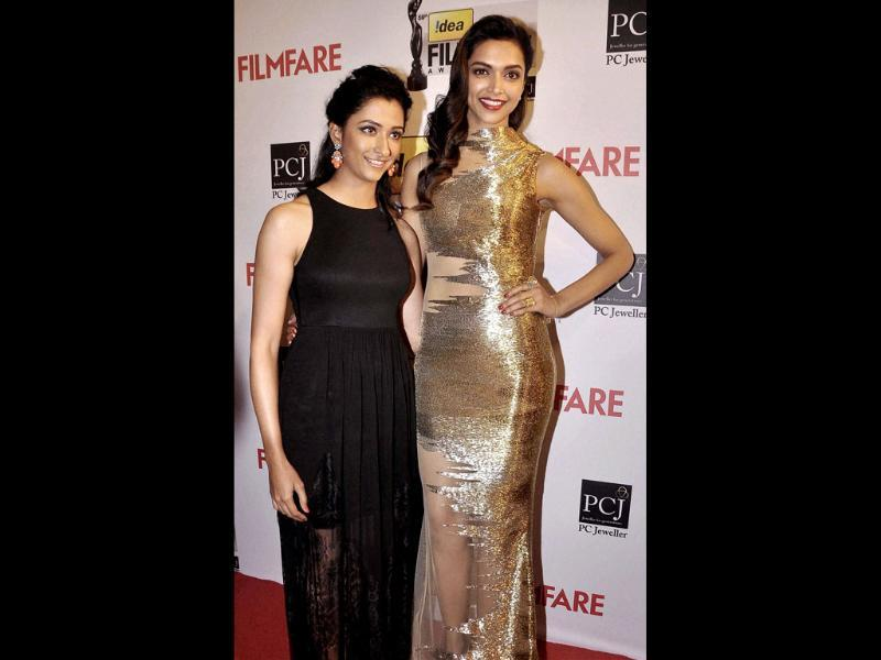 Evening dresses and glitzy gowns are as much a mainstay of Red Carpet events in India as in Hollywood. Deepika Padukone in a gold-and-sheer number is glam personified. The actor poses with her sister before an awards nite.