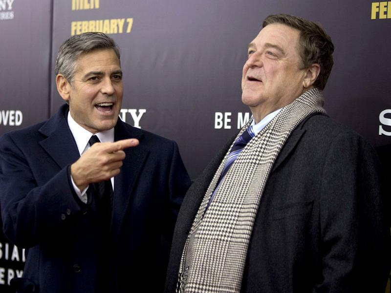 George Clooney and John Goodman arrive for the premiere of their movie The Monuments Men in New York.