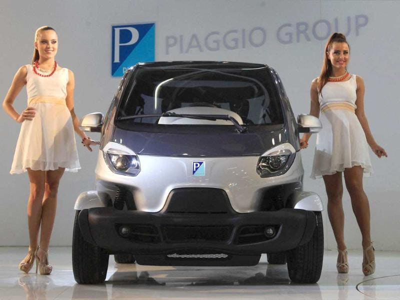 Models pose near Piaggio's newly unveiled NT3 concept vehicle during the 12th Auto Expo 2014 in Greater Noida. (PTI Photo)