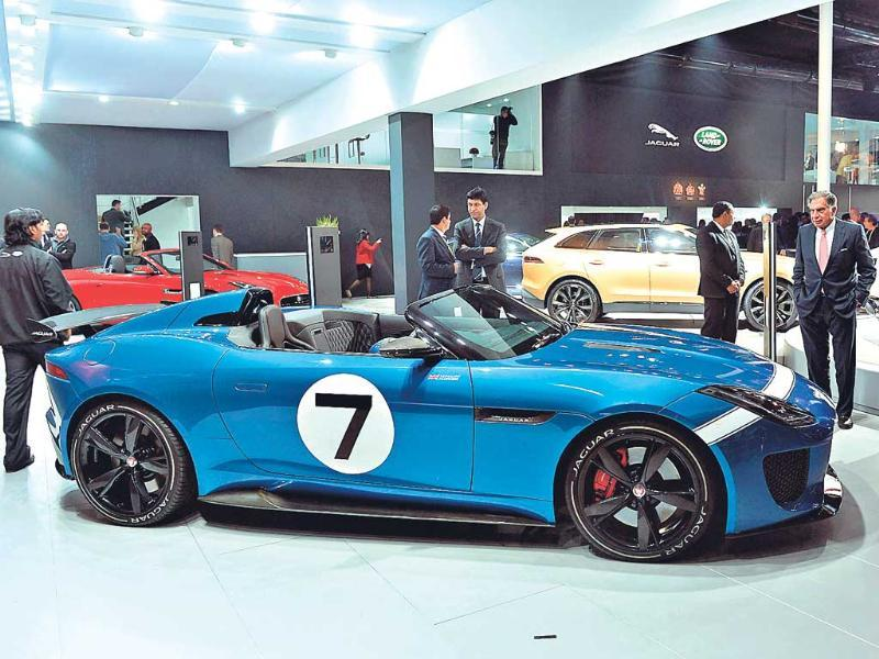 Ratan Tata stands near the Jaguar project 7 car at the 12th Auto Expo in Greater Noida. (AFP Photo)
