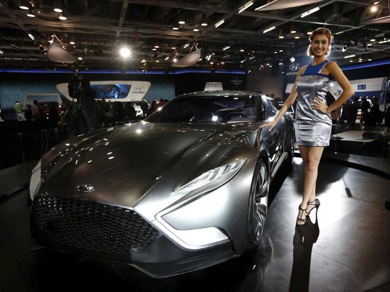 A model stands next to a Hyundai HND-9 Venace concept car during the 12th Auto Expo in Greater Noida. (Reuters photo)