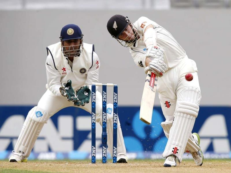 New Zealand's Kane Williamson (R) hits out as MS Dhoni (L) watches, on day one of the first Test at Eden Park in Auckland. (Reuters Photo)