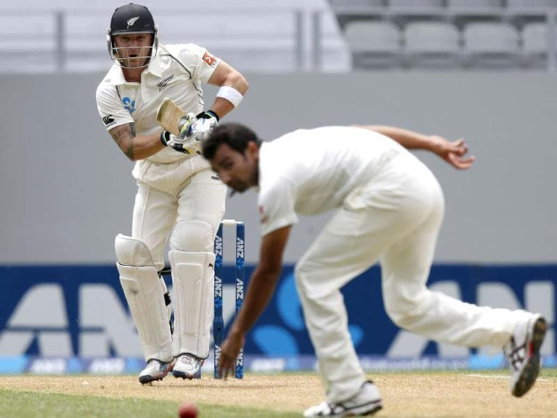 New Zealand's Brendon McCullum (L) hits the ball past Mohammed Shami for four runs on day one of the first Test at Eden Park in Auckland. (Reuters Photo)