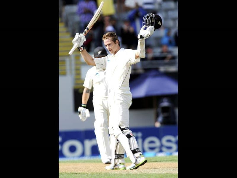New Zealand's Kane Williamson acknowledges his century against India on the first day of the first Test at Eden Park in Auckland. (AP Photo)