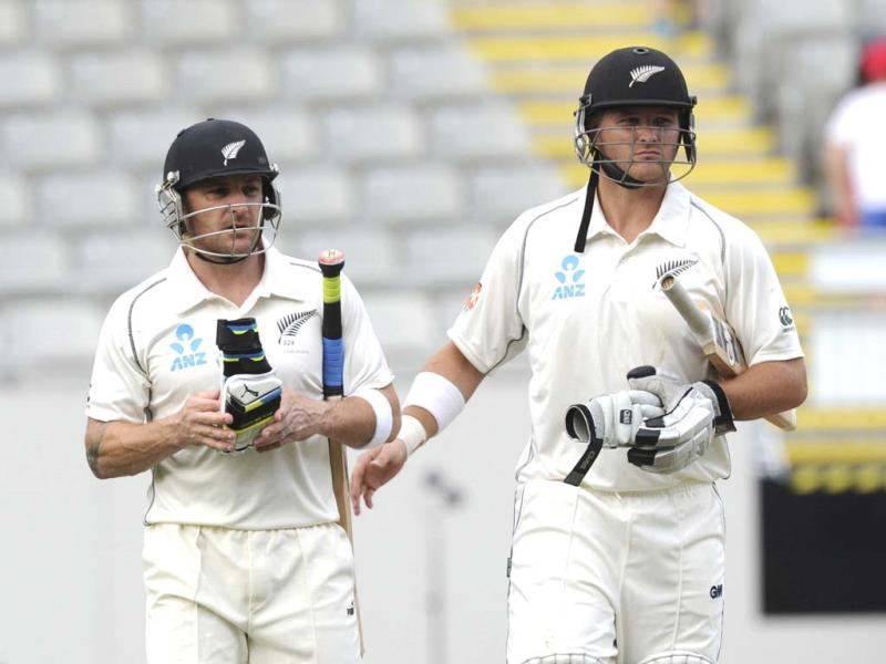 New Zealand's Brendon McCullum (L) leaves the pitch with Corey Anderson at the end of play against New Zealand on the first day of the first Test at Eden Park in Auckland, New Zealand. (AP Photo)