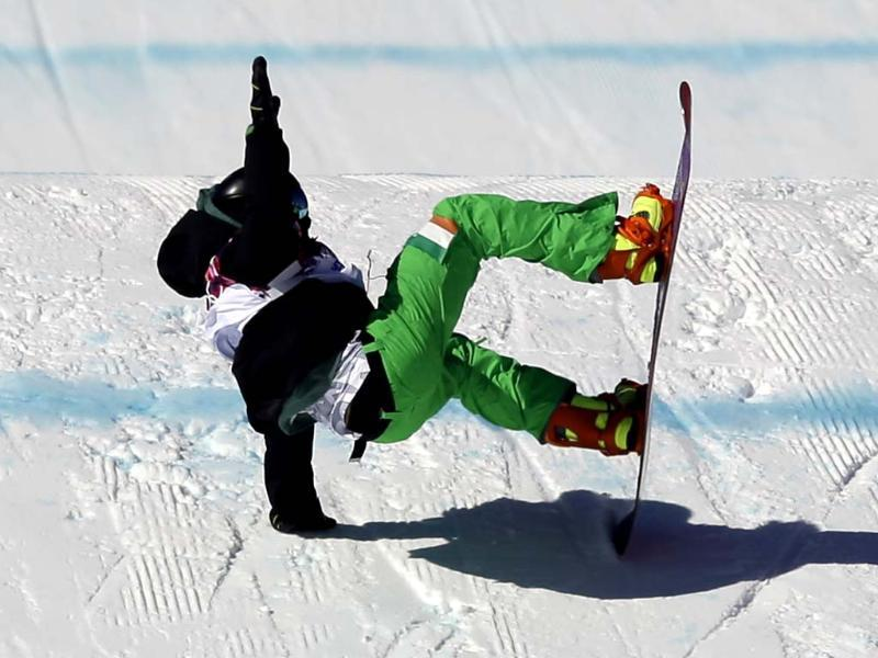 Ireland's Seamus O'Connor crashes during the men's snowboard slopestyle qualifying at the Rosa Khutor Extreme Park ahead of the 2014 Winter Olympics in Krasnaya Polyana, Russia. (AP photo)