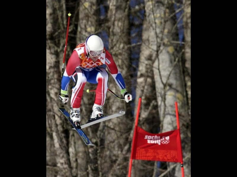 France's David Poisson jumps during men's downhill training at the Sochi 2014 Winter Olympics in Russia. (AP photo)